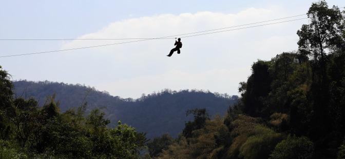 Zip-lining across the Pasak River
