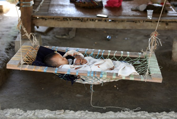 Baby in a home-made cradle