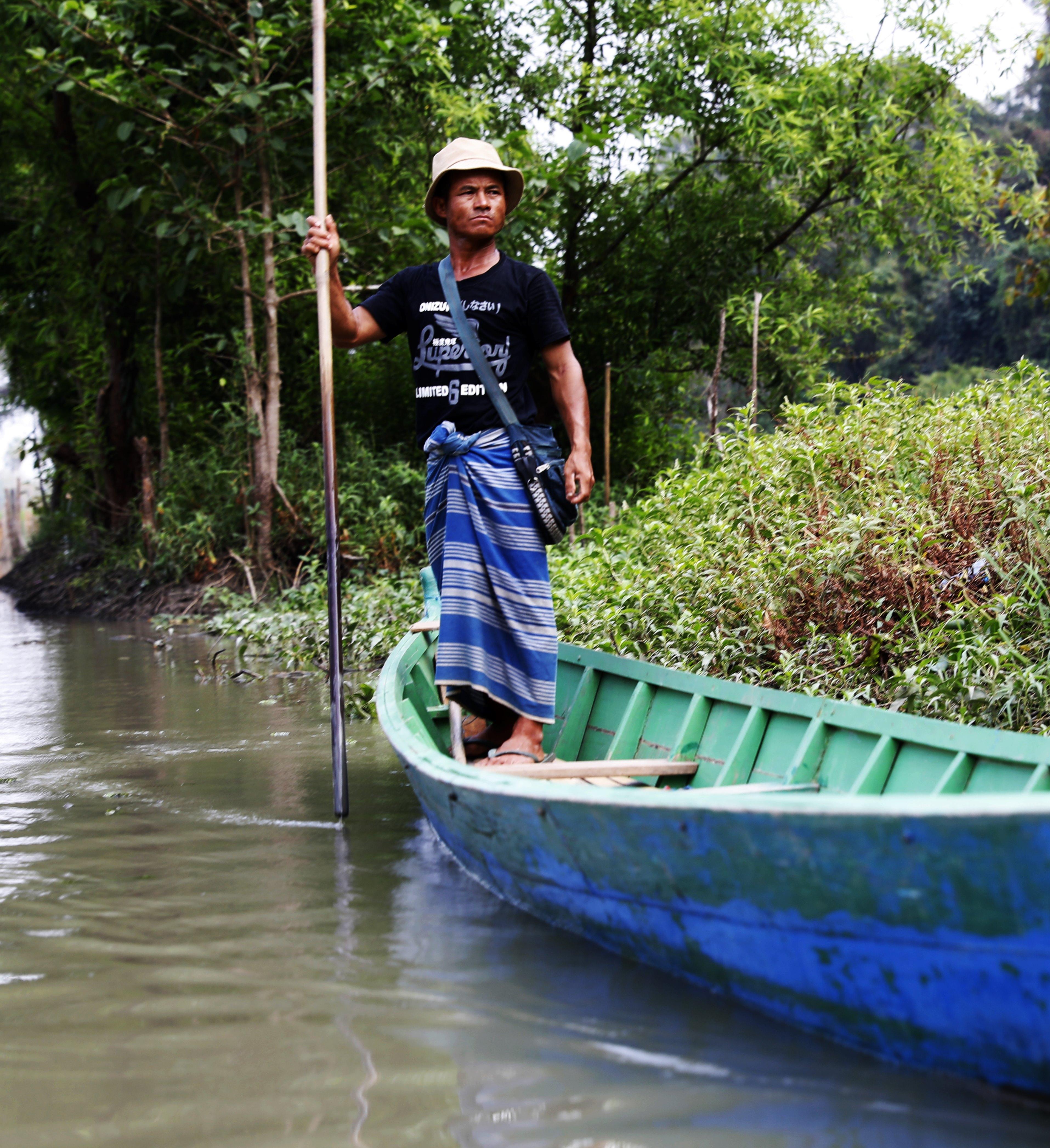 Burmese man in a long boat.
