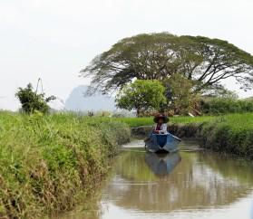 Burmese woman in a long boat