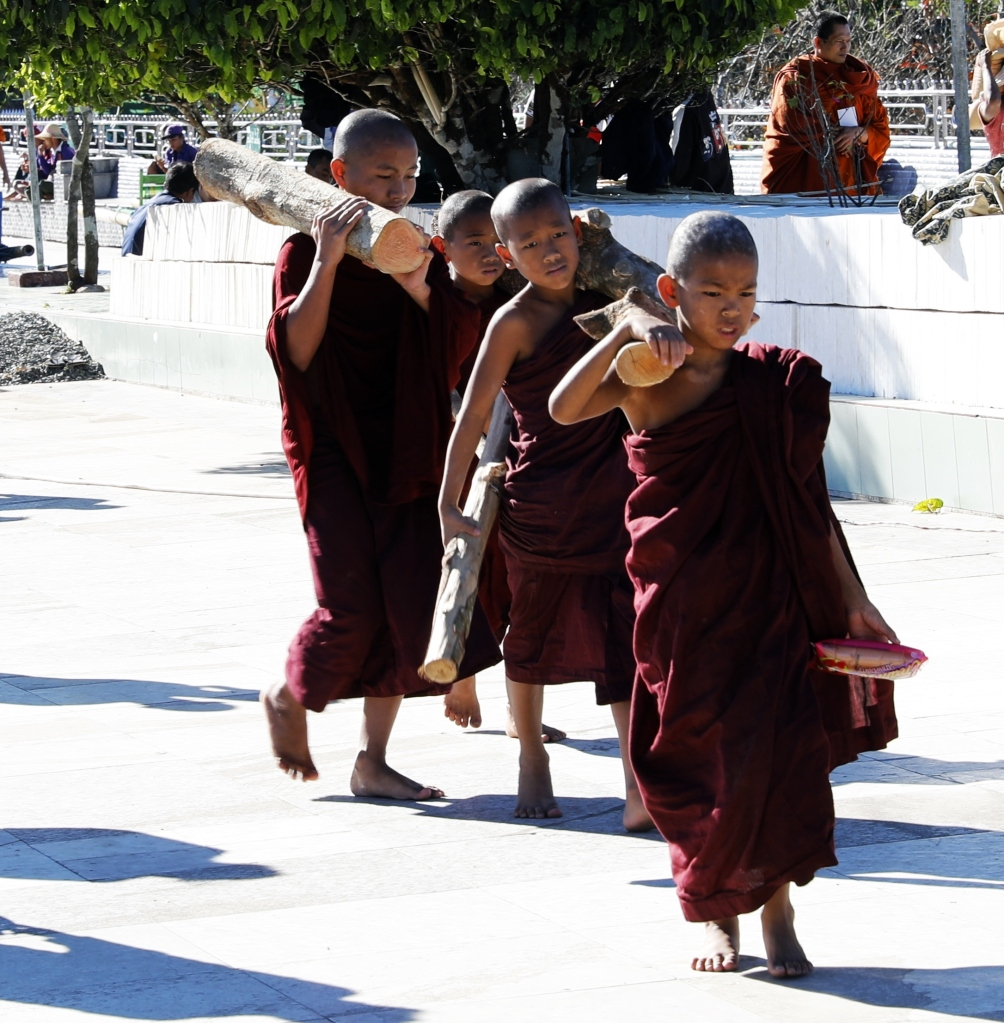 Monks carrying firewood to monastery at Golden Rock