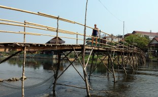 Bamboo bridge rebuilt after each rainy season, Vang Vieng