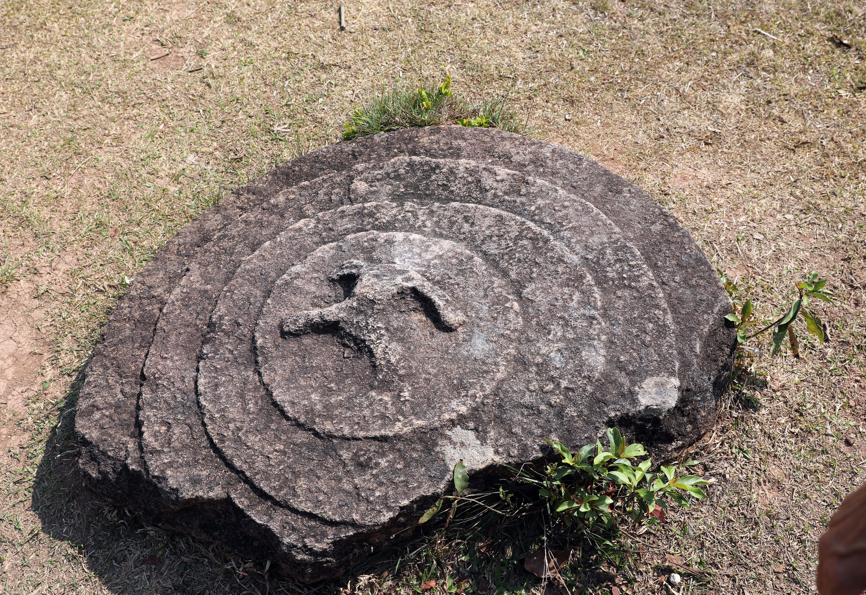 Decorated disc in Plain of Jars, Phonsavan