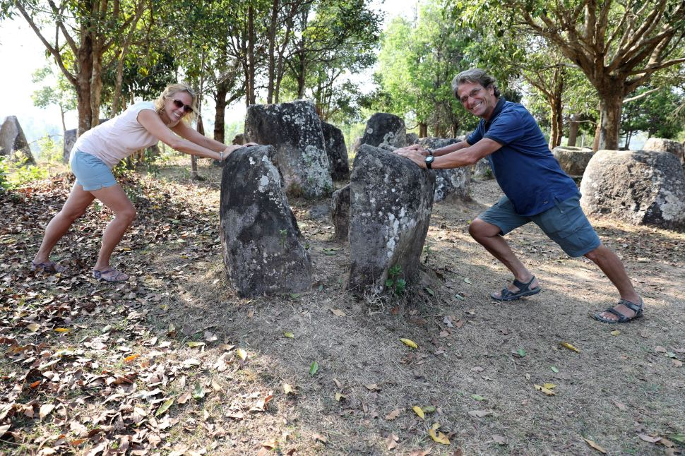 Closing one of the broken jars in Plain of Jars, Phonsavan