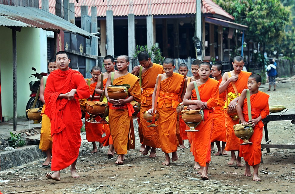 Monks returning to their monastery after Alms Collection Ceremony