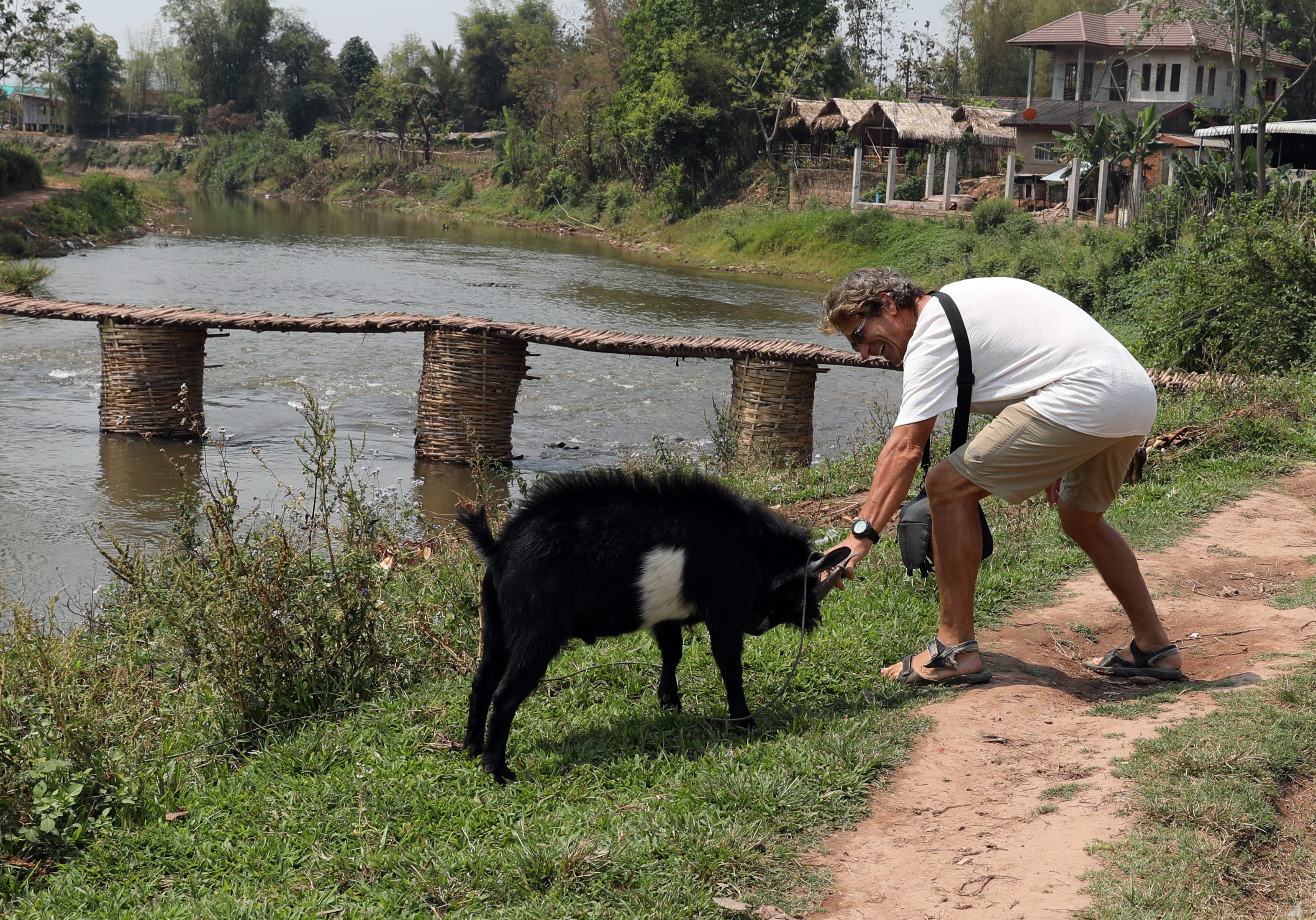 Richard teasing a goat