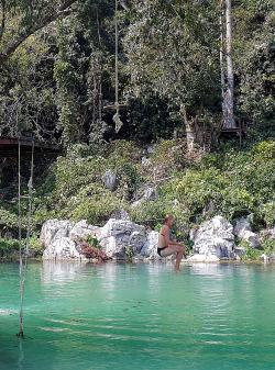 Jumping off platform at Blue Lagoon, Vang Vieng