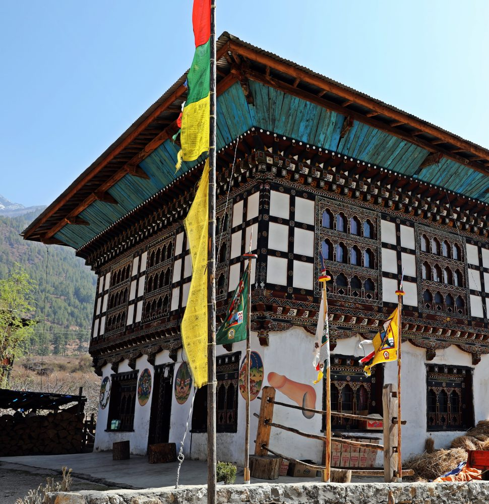 Traditional Bhutanese architecture, including phallus symbol on the wall.