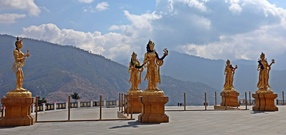 Statues of heavenly figures surrounding Buddha View