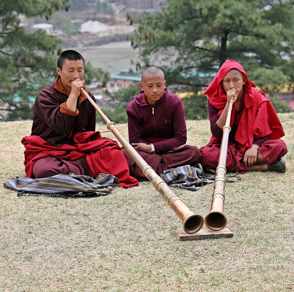Monks practicing on their Dungchens at their monastery