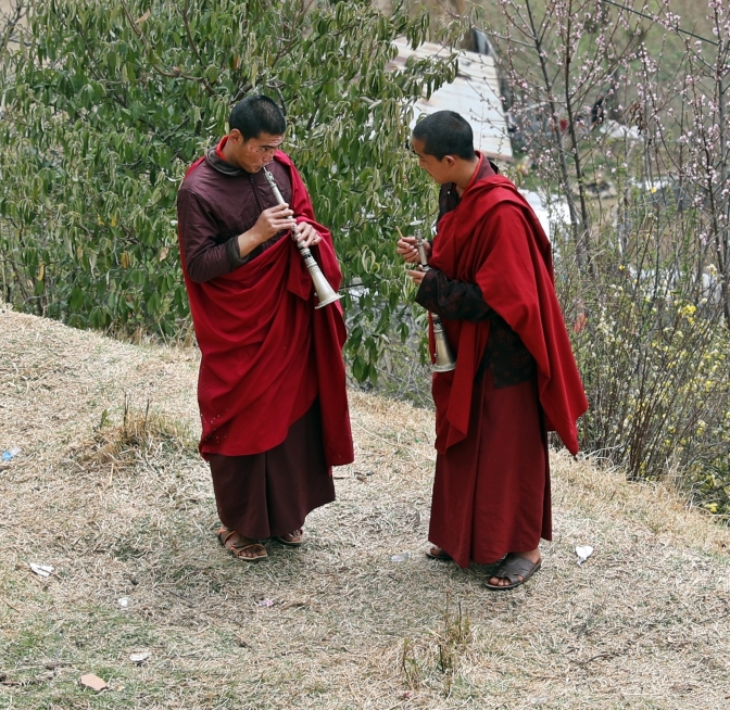 Monks practicing oboes at monastery