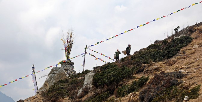 Porters, chortens and prayers flags.