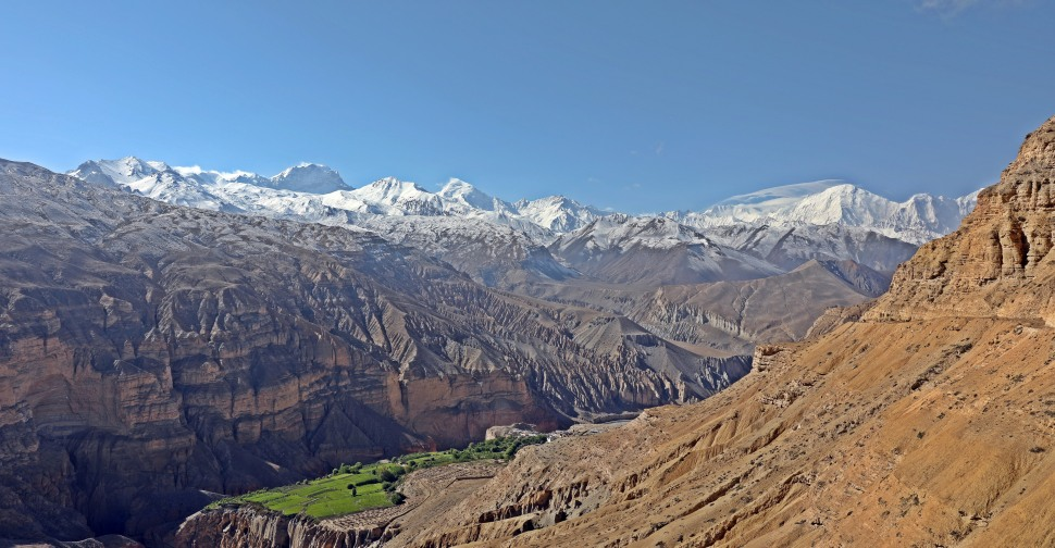 The oasis village of Chele below with the Annapurna and Dhaulagiri Ranges in the background