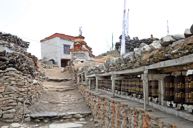 Buddhist prayer wheels in the village of Chele