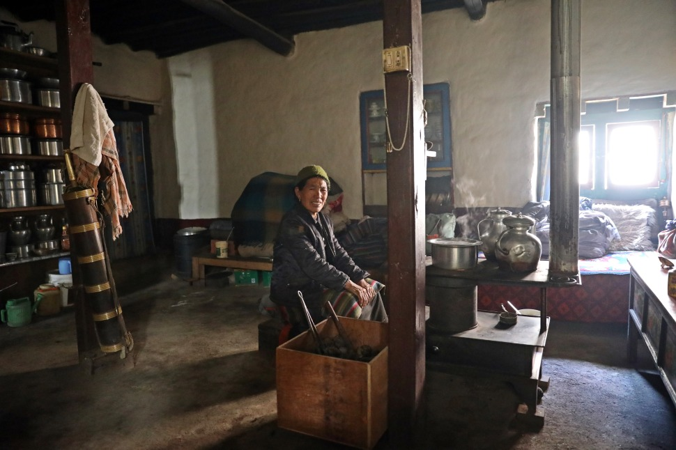 Lady in her kitchen, Lo Manthang