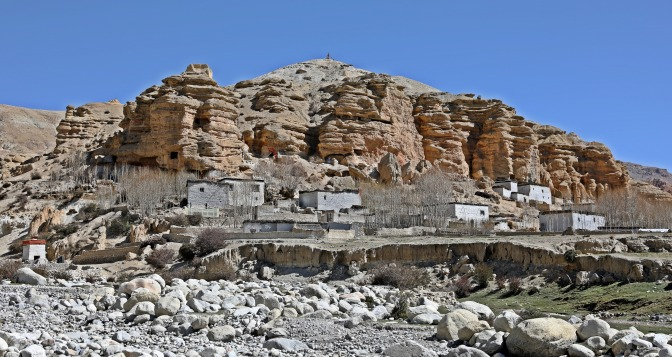 Cliff caves above the village of Chhosar