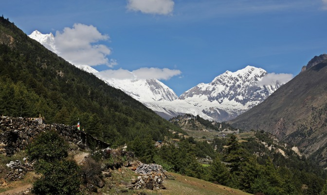 Mt Manaslu (far left) and the village of Lho