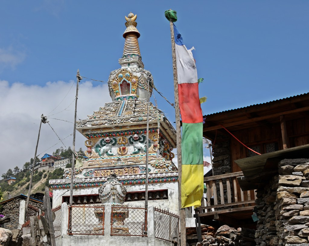 Decorated chorten in the village of Lho
