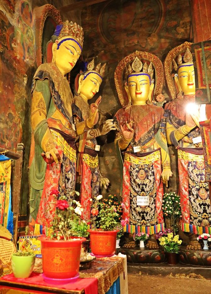 Buddha statues inside Phalkor Gompa