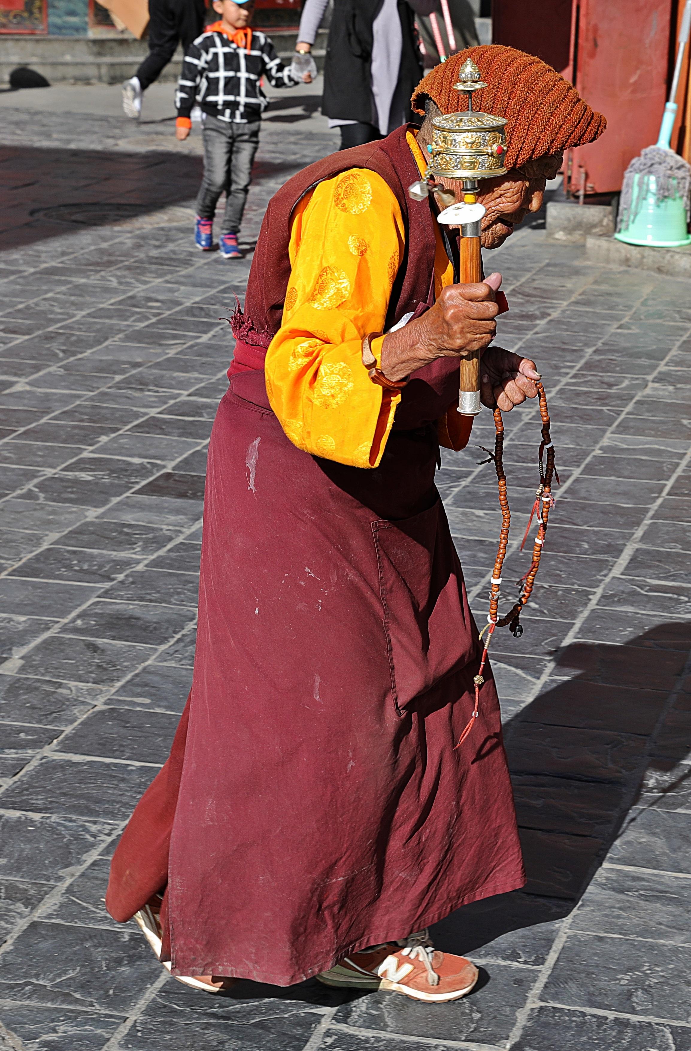 Old lama in Barkhor Bazaar, Lhasa