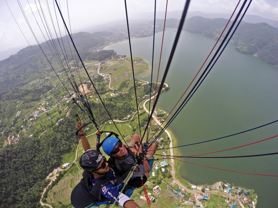 Paragliding above Fewa Lake