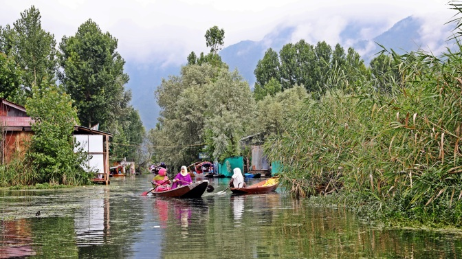 Locals on dugout boats on Dal Lake