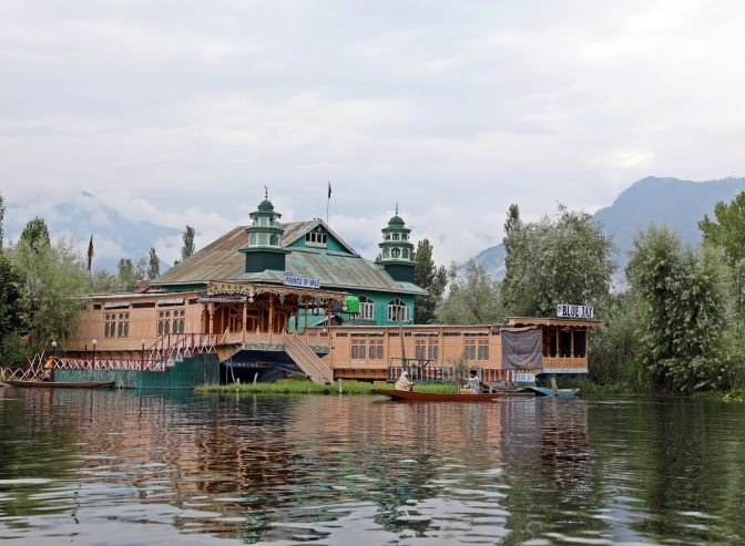 A mosque behind houseboats on Dal Lake, Srinagar