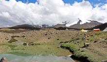 Small lake on a grassy high plateau