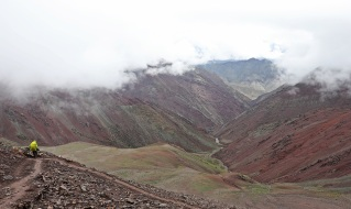 Descending into a colourful valley after Kongmaru La