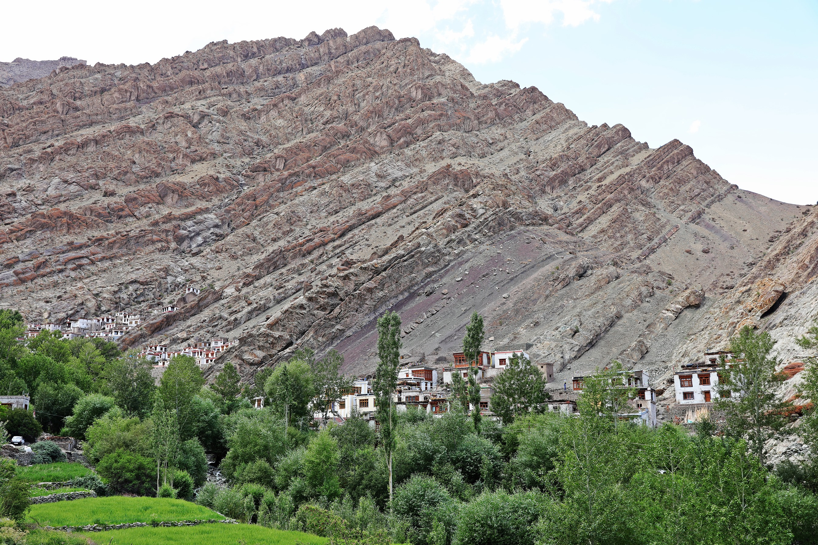 Steep hill with Hemis Gompa on the left, village on the right