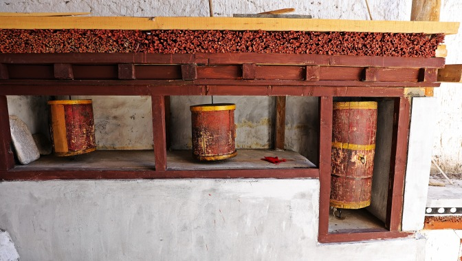 Old prayer wheels in Thekchhok Gompa