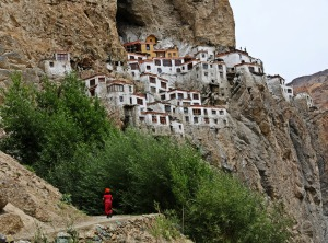 A novice monk on his way to Phuktal Gompa