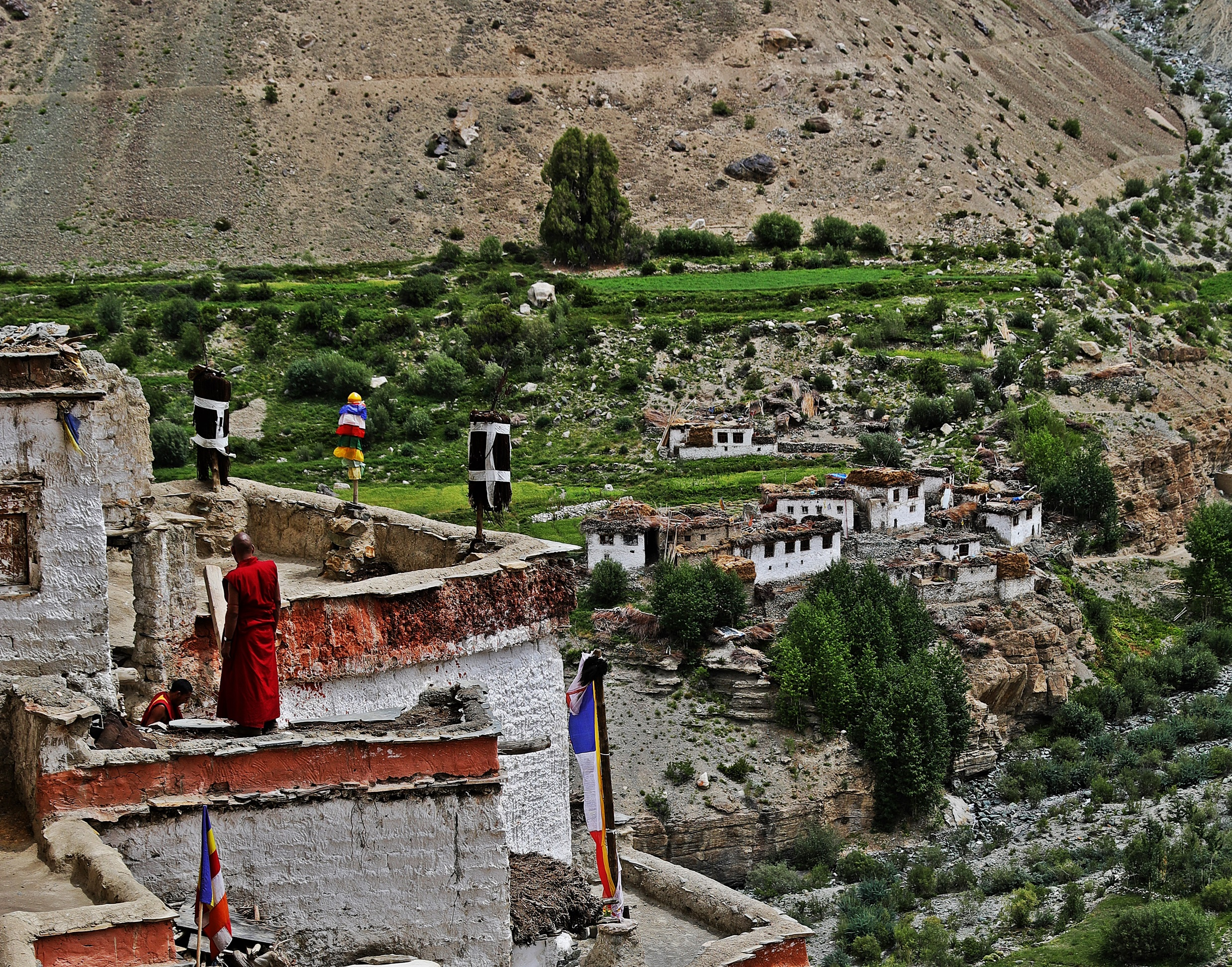 Lamas on the roof of Phuktal Gompa