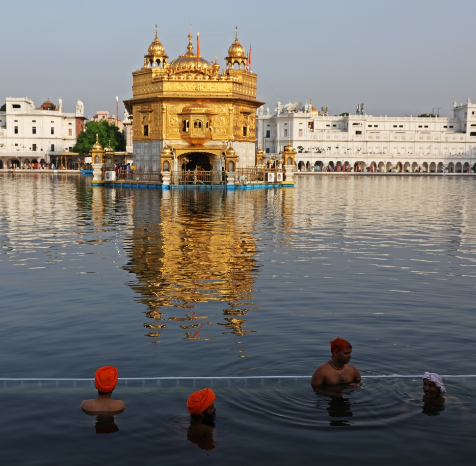 Men bathing in the Sarovar, Amritsar