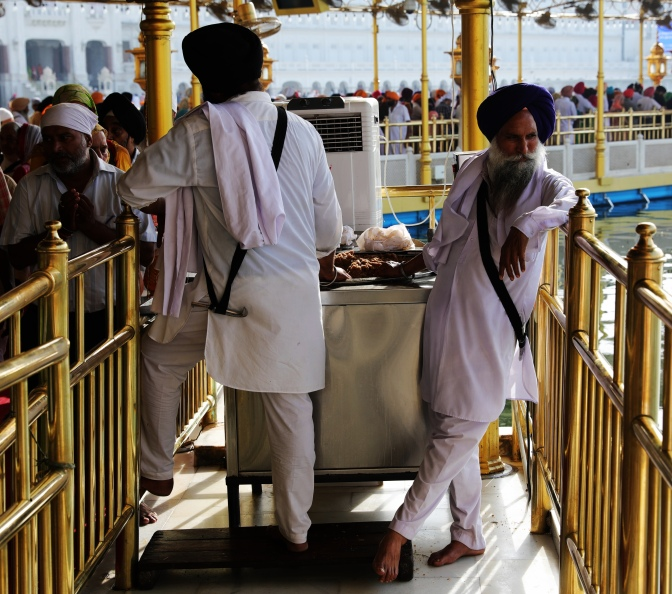 Serving free food with their hands at the Golden Temple