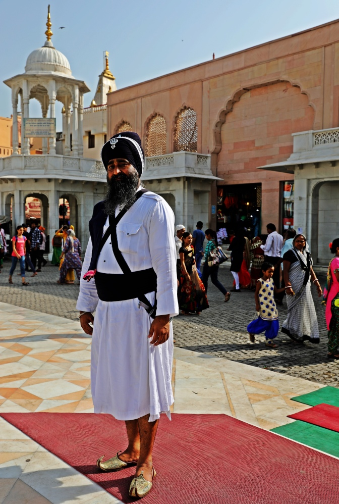 Sikh man dress in traditional dress and shoes