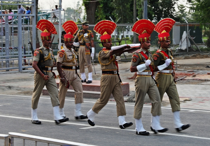 Indian Border Guards carrying the flag