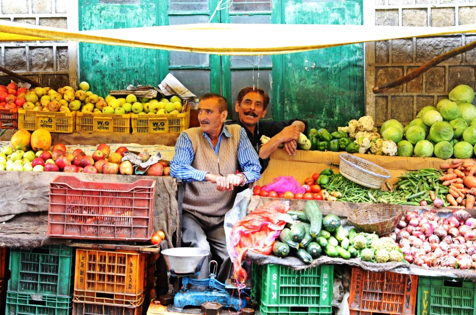 Friendly men at their vegetable stall on a rainy day in McLeod Ganj