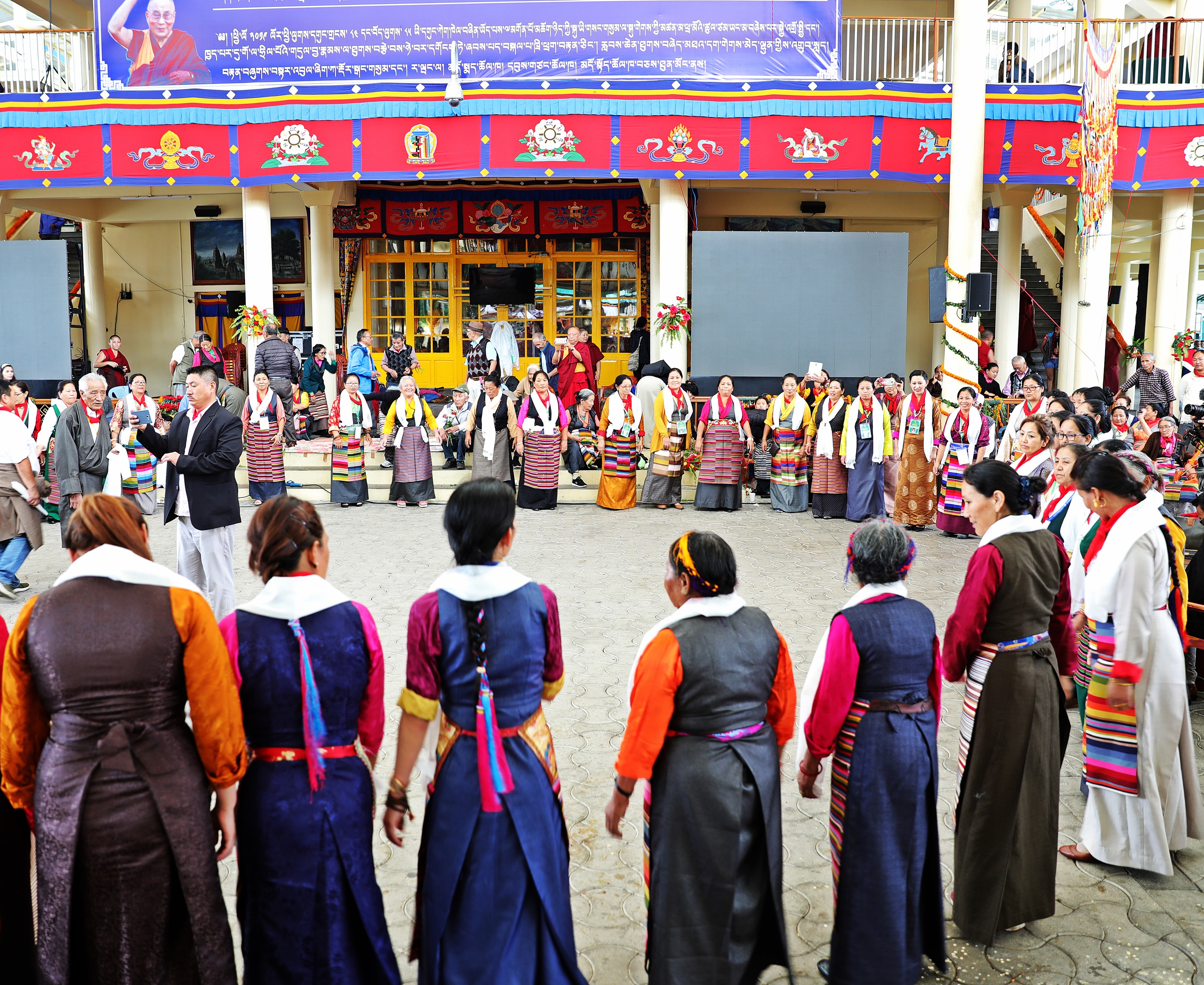 Tibetans dancing in the Tsuglagkhang Complex