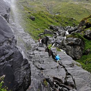 Crossing under a waterfall, Hampta Pass Trek