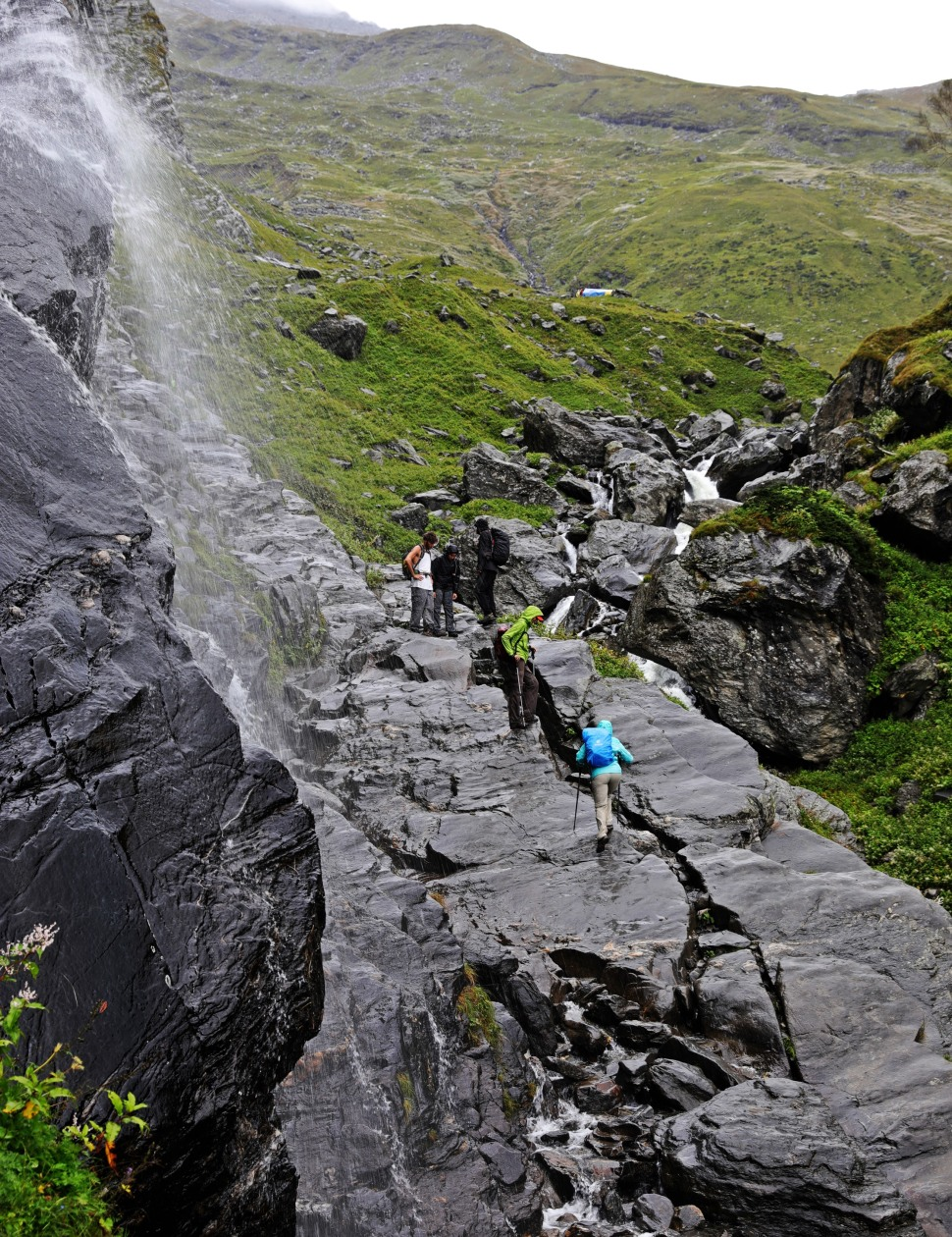 Crossing under a waterfall, Hampta Pass Trek