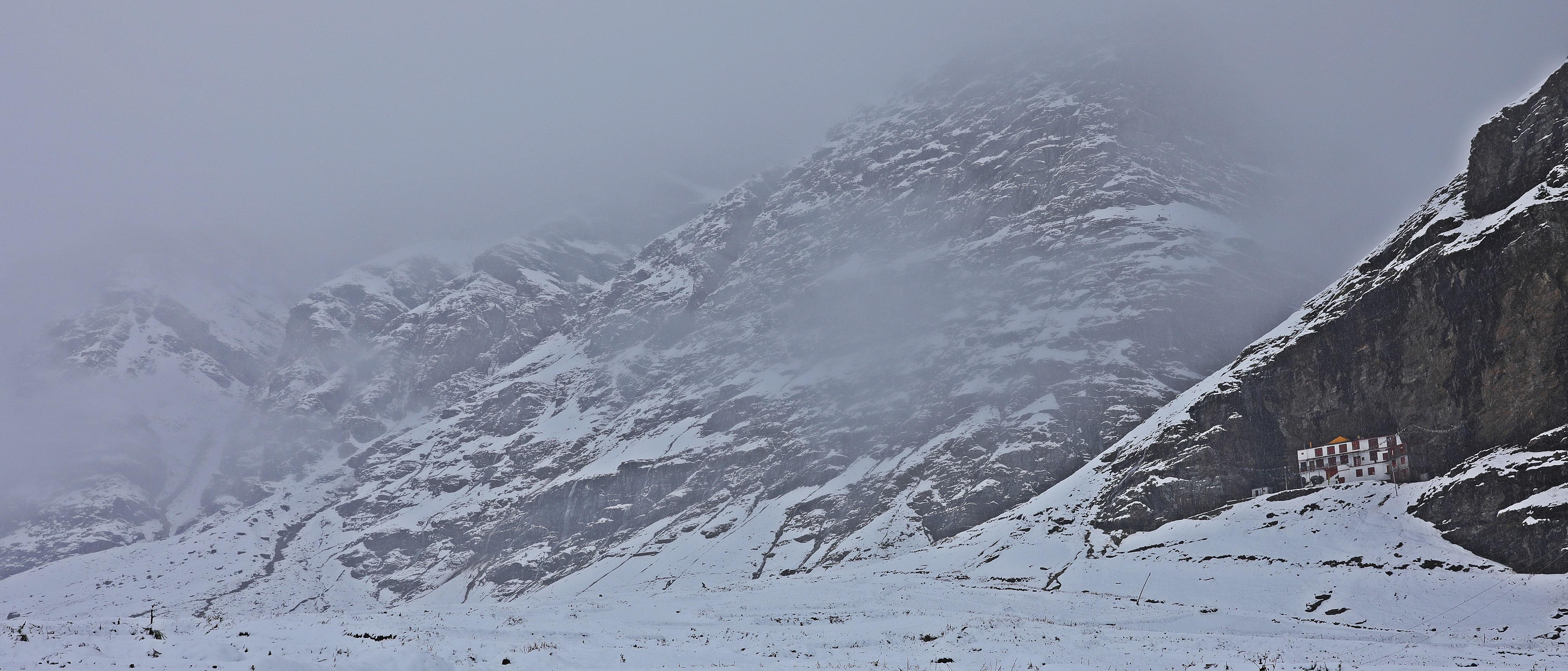 Buddhist Gompa amid swirling snow in Khoksar