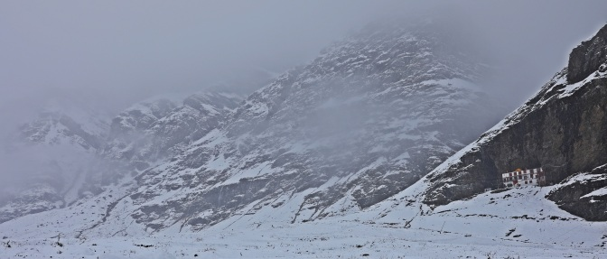 Buddhist Gompa amid swirling snow in Khoksar