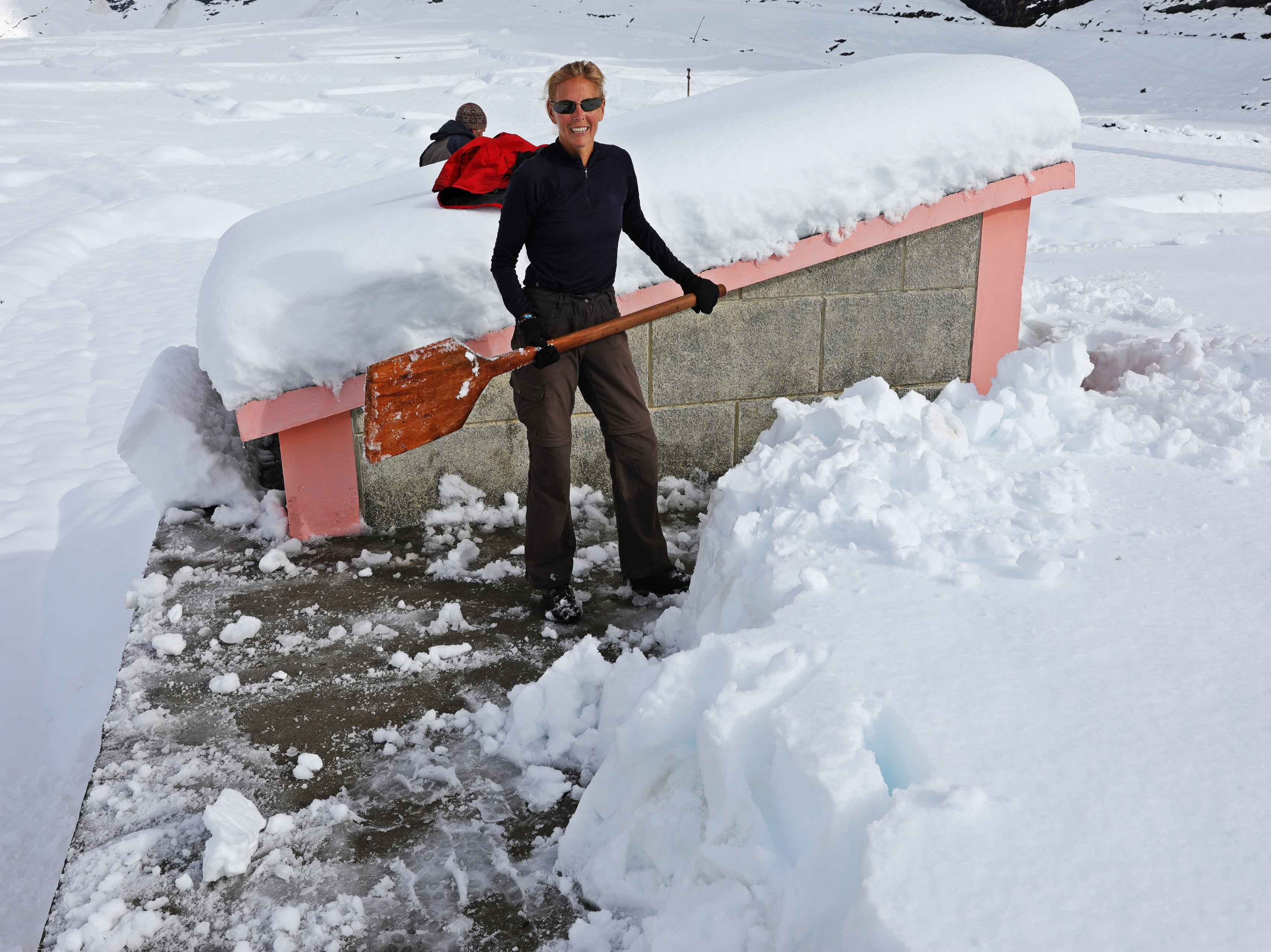 Shoveling snow with a pizza paddle