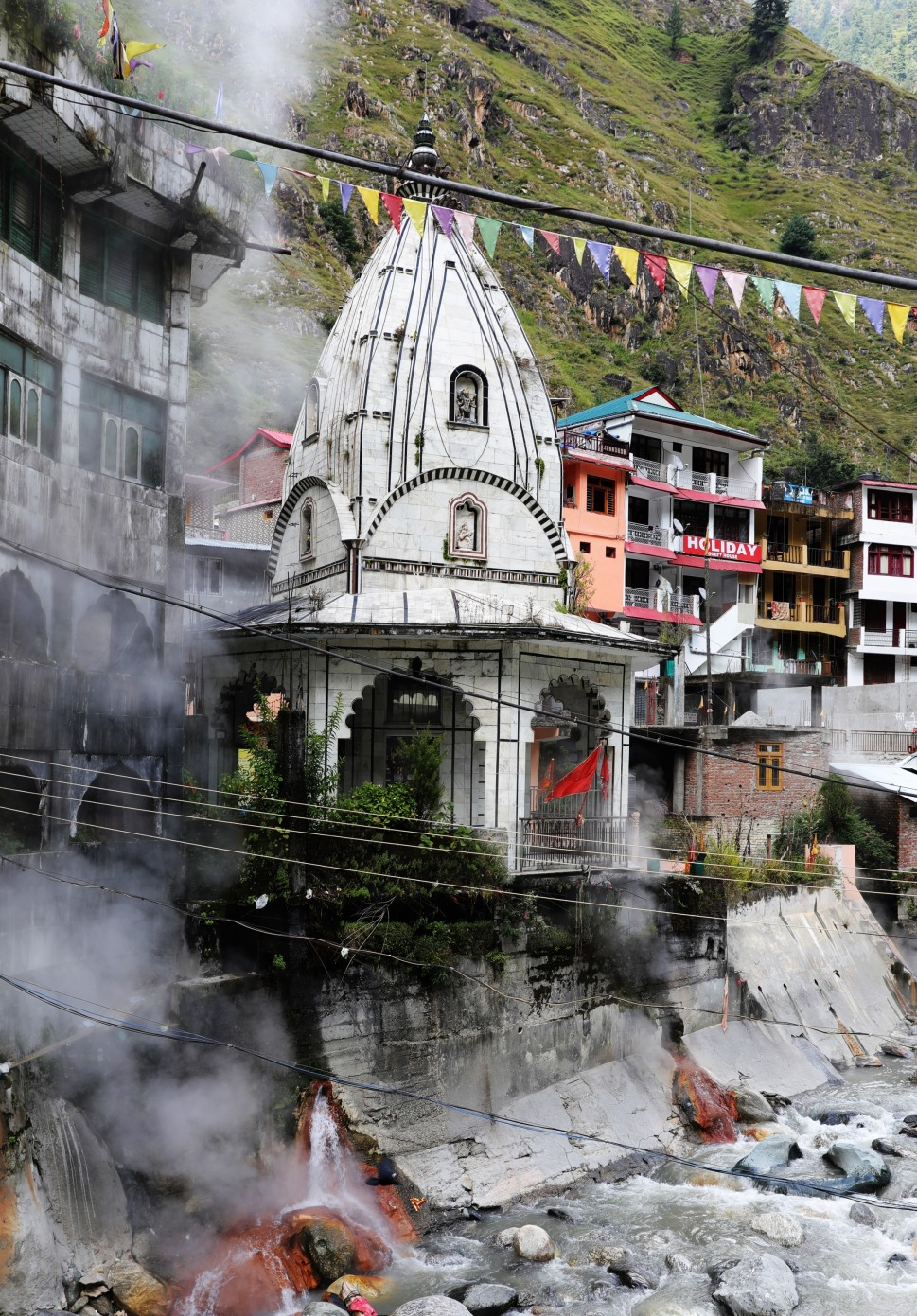 Hot springs steam rising beside the Hindu Temple, Manikaran