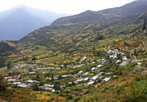 Village of Pana with ripe amaranth fields on the terraces
