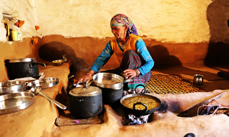 Our assistant guide's mom making lunch in their home in Pana