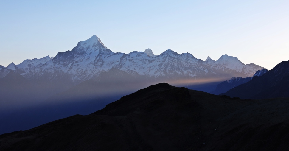 Sunrise rays below beside Nanda Devi from Kuari Pass