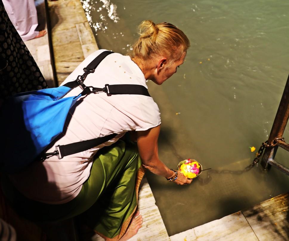 Putting a diya in the Ganges