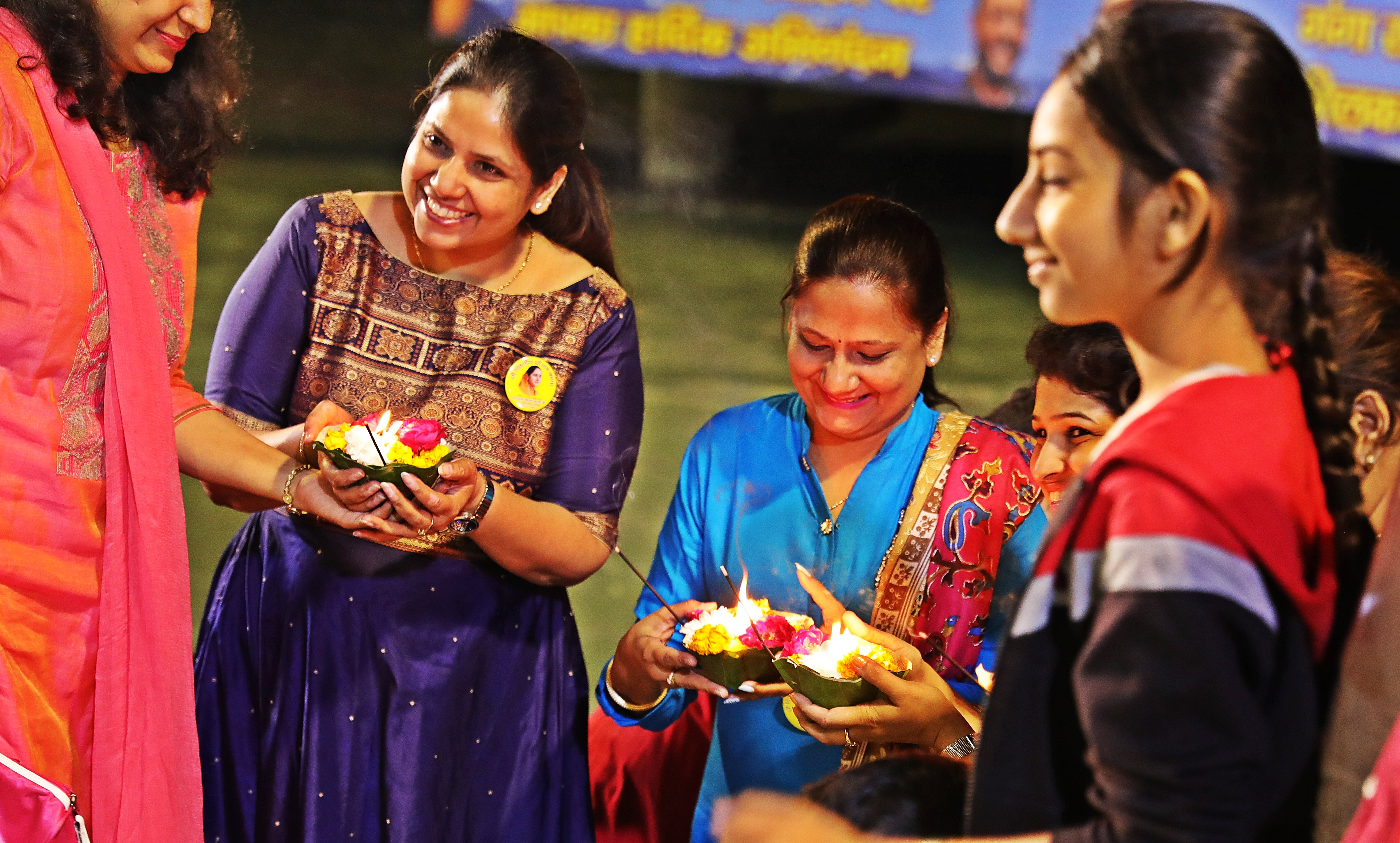 Hindu ladies with diyas